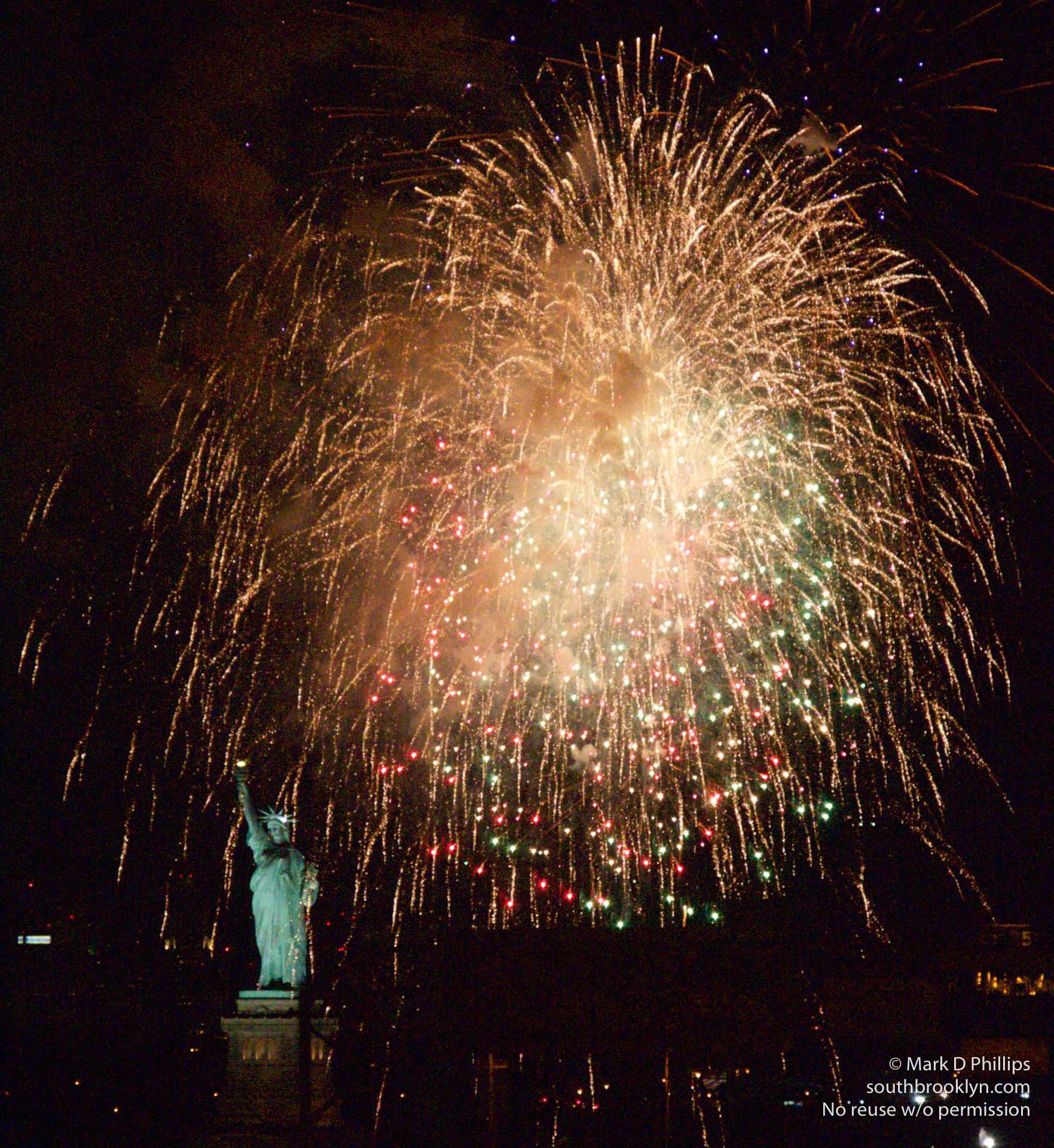 Fireworks over the Statue of Liberty on New Year's Eve at midnight 2015