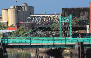 Graffitti adorns buildings around the Carroll Street Bridge over Gowanus Canal in Brooklyn, NY