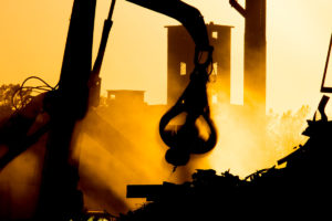 A crane lifts scrap at Benson Scrap Metal