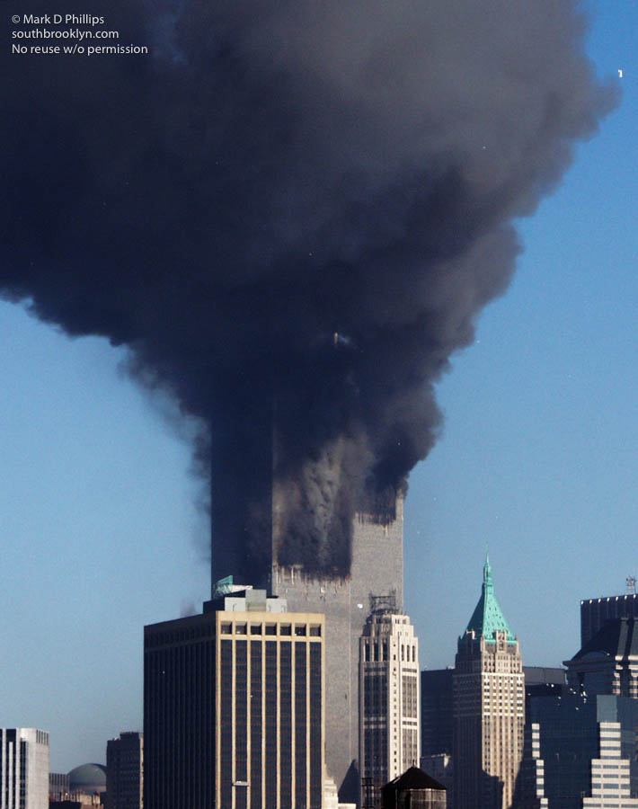 Satan in the smoke of World Trade Center on September 11, 2001 just seconds after the second plane struck the south tower. MANDATORY CREDIT: ©2001,markdphillips.com/Mark D. Phillips NOT TO BE PRINTED OR RETRANSMITTED WITHOUT EXPRESSED WRITTEN PERMISSION OF THE COPYRIGHT HOLDER.
