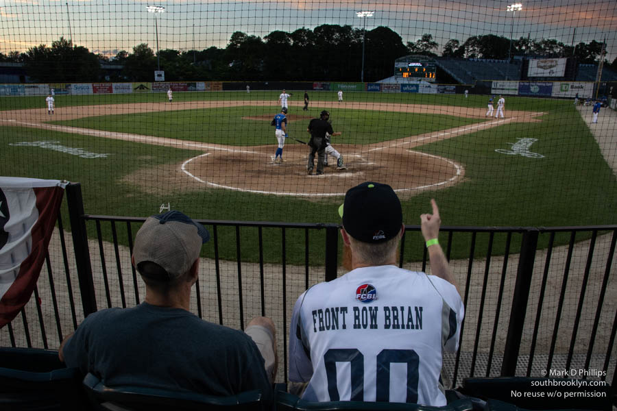 Front Row Brian calls a strike during the first game of a doubleheader against the North Shore Navigators. ©Mark D Phillips
