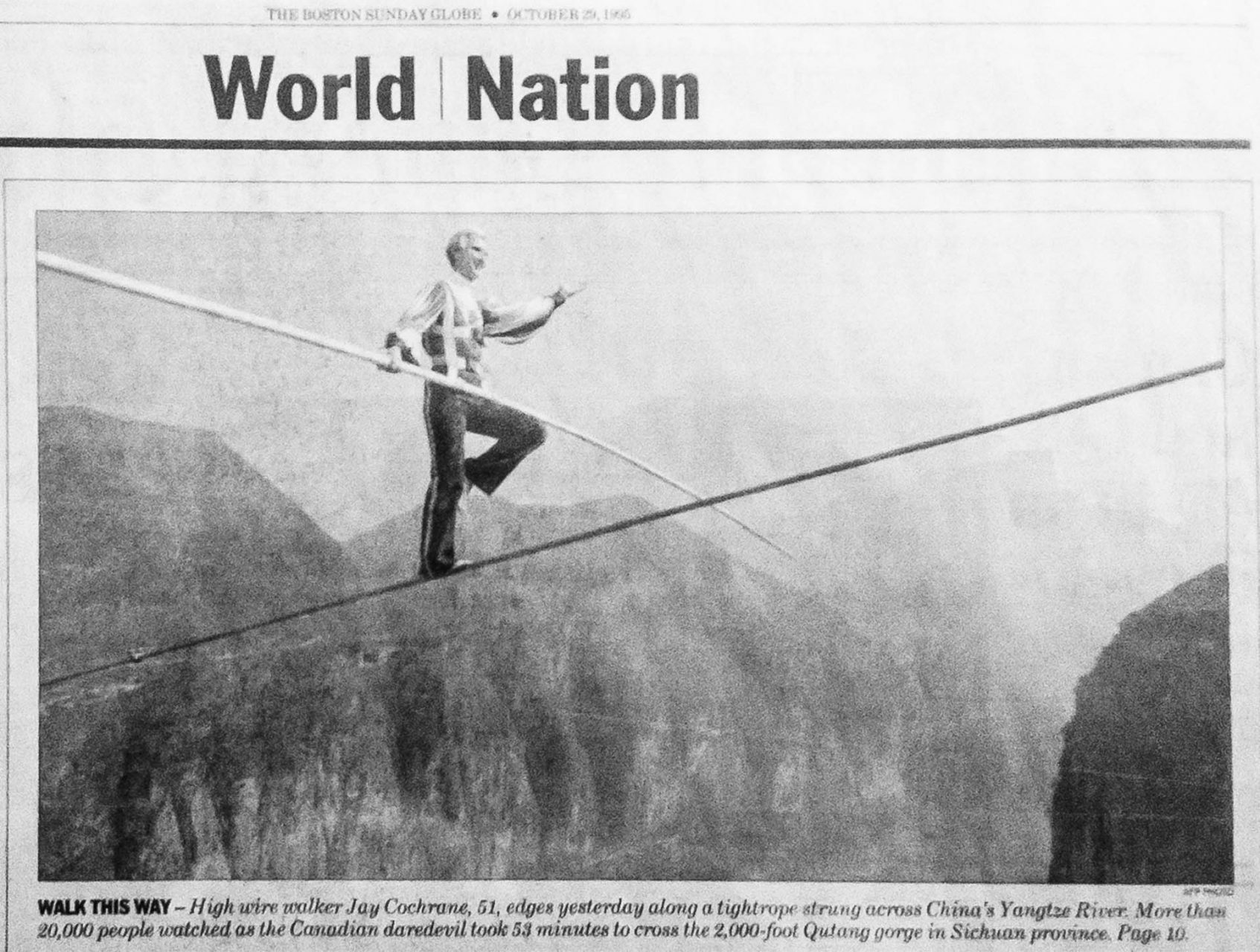 "Jay Cochrane, ""The Prince of the Air"", published in the Boston Globe on October 29, 1995, day after The Great China Skywalk over the Yangtze River in Qutang Gorge, China, on October 28, 1995. The skywalk was and is the greatest ever made spanning half a mile between the canyon walls and 1,350 feet above the river. ©Mark D Phillips"